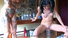 naked girl peeing in a graduated glass cylinder