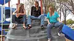 Mela, Georgia, and Vicktoria prepare to wet their jeans