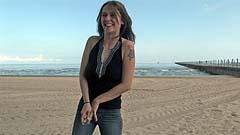 Mela deliberately wetting herself on a beach