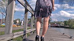 Georgia walking and peeing on a boardwalk