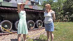 Vicktoria and Georgia wetting panties by an Army tank