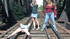 Georgia, Mela, and Vicktoria wetting on a train track