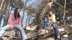 Vicktoria and Mela climb a falled tree trunk
