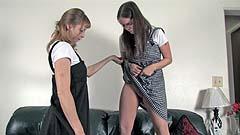 Vicktoria lifts up Mela's dress