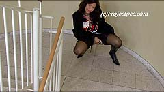 Carment peeing on a staircase