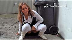 Yassie peeing near a bus stop