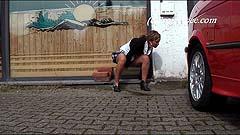 Yassie peeing on a main street