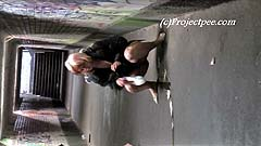 Lindsay peeing in an underpass