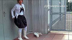 Yassie pulls up her skirt