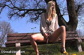 blonde peeing on a bench