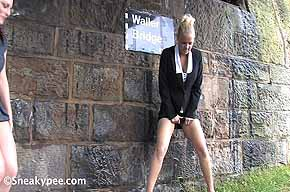 peeing by a wall