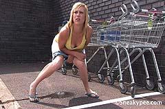 girl peeing next to shopping carts