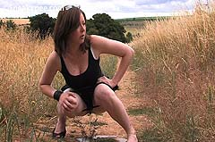 squatting to pee in a field