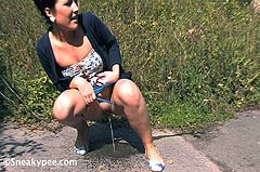 girl peeing on sidewalk
