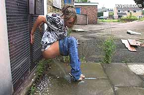 peeing while leaning on a building