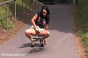 girl peeing on walkway